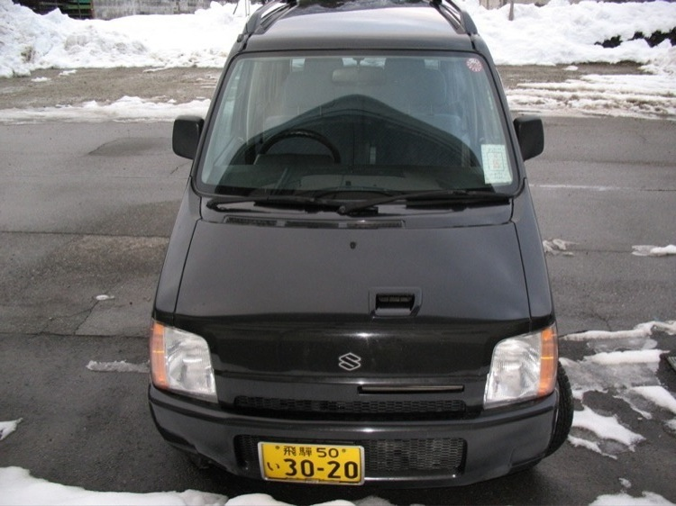 A frontal view of my car, a Suzuki Wagon R, in Japan.